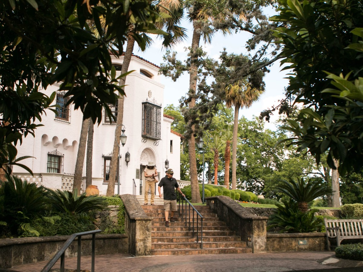 A couple exits the McNay Art Museum.