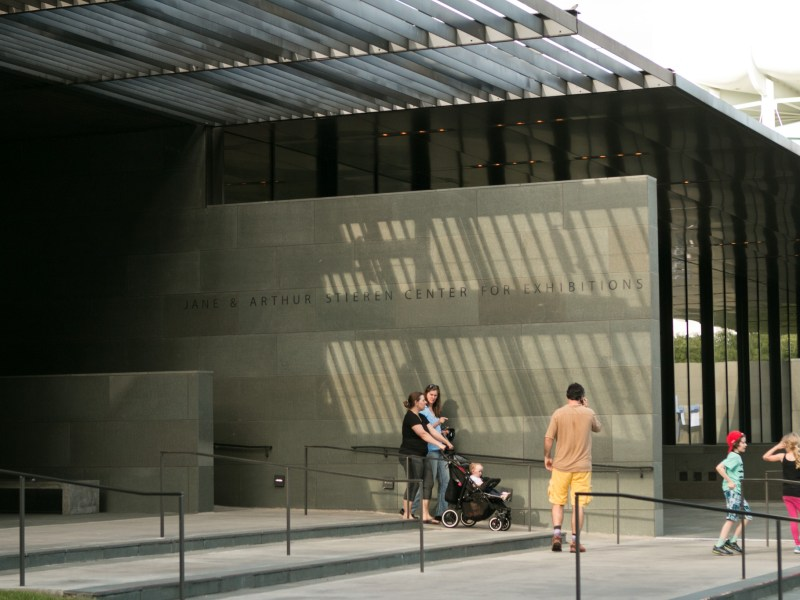 A family walks outside of the McNay Art Museum.