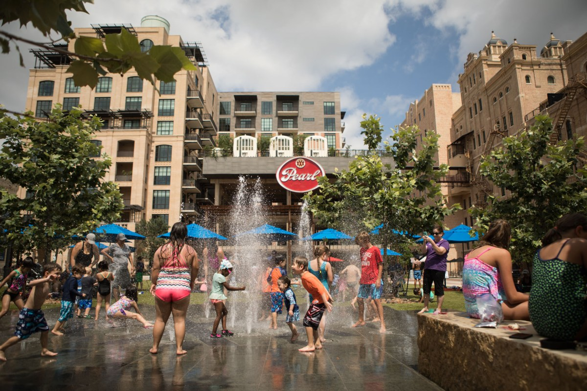 Children play in the fountains at the Pearl.