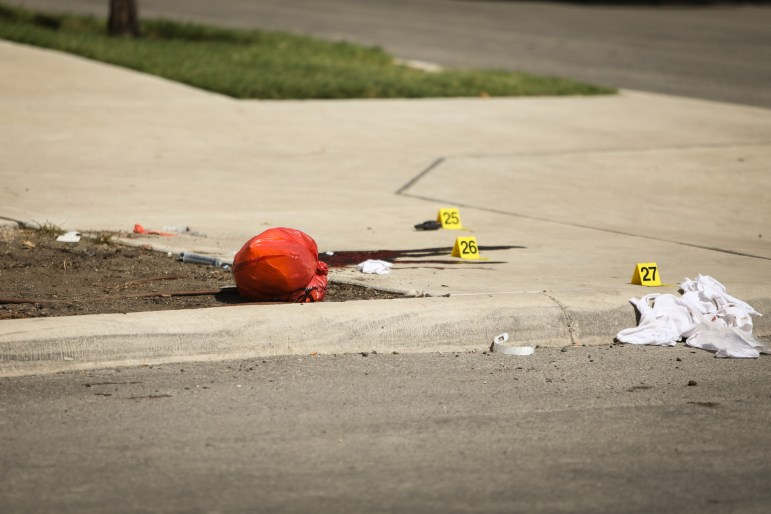 Blood can be seen at the crime scene on Evergreen Street and Howard Street.
