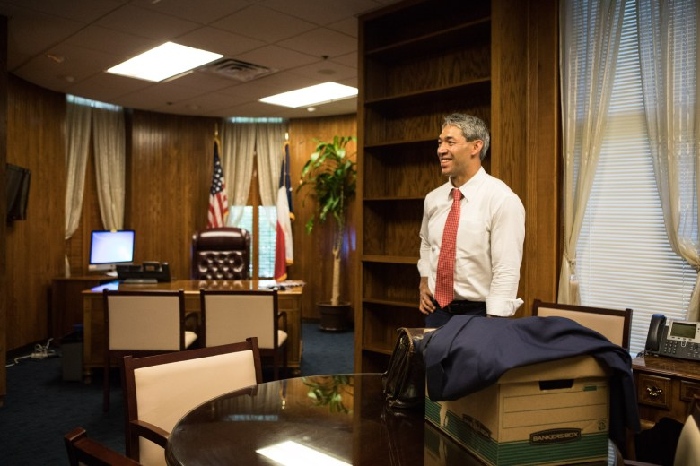 Mayor-elect Ron Nirenberg moves a box into his new office inside City Hall.
