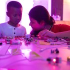 Girls Inc. Scholar Vishali, 13, right, explains to Nicholas, 6, how to use littleBits at the San Antonio Museum of Science and Technology.