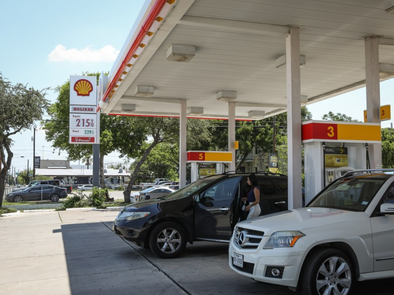 A woman enters her car at a Shell gas station on the corner of Alamo Street and Brooklyn Avenue.