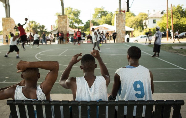 Basketball players show their excitement at the basketball tournament held for the Stand Up SA peace initiative in Lockwood Park.