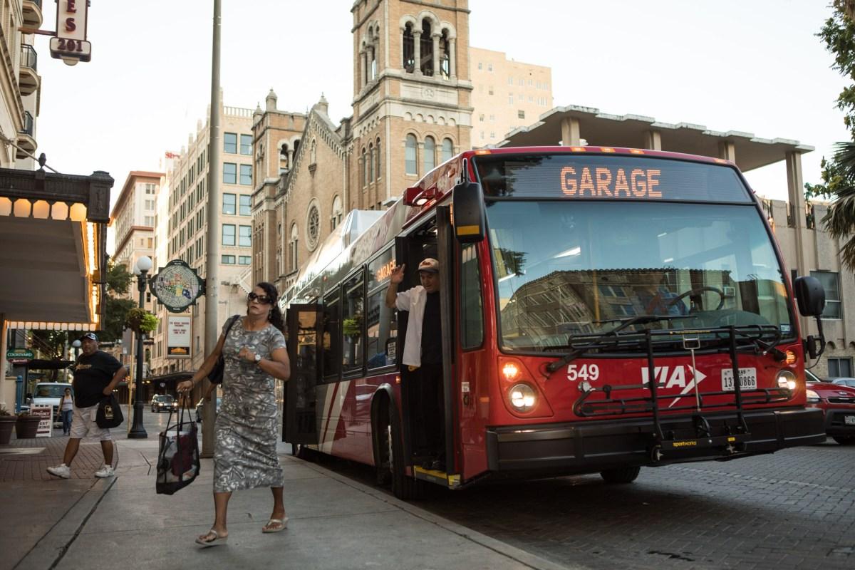 A woman exits a VIA Metropolitan Transit bus at the corner of St. Mary's Street at Crockett Street.