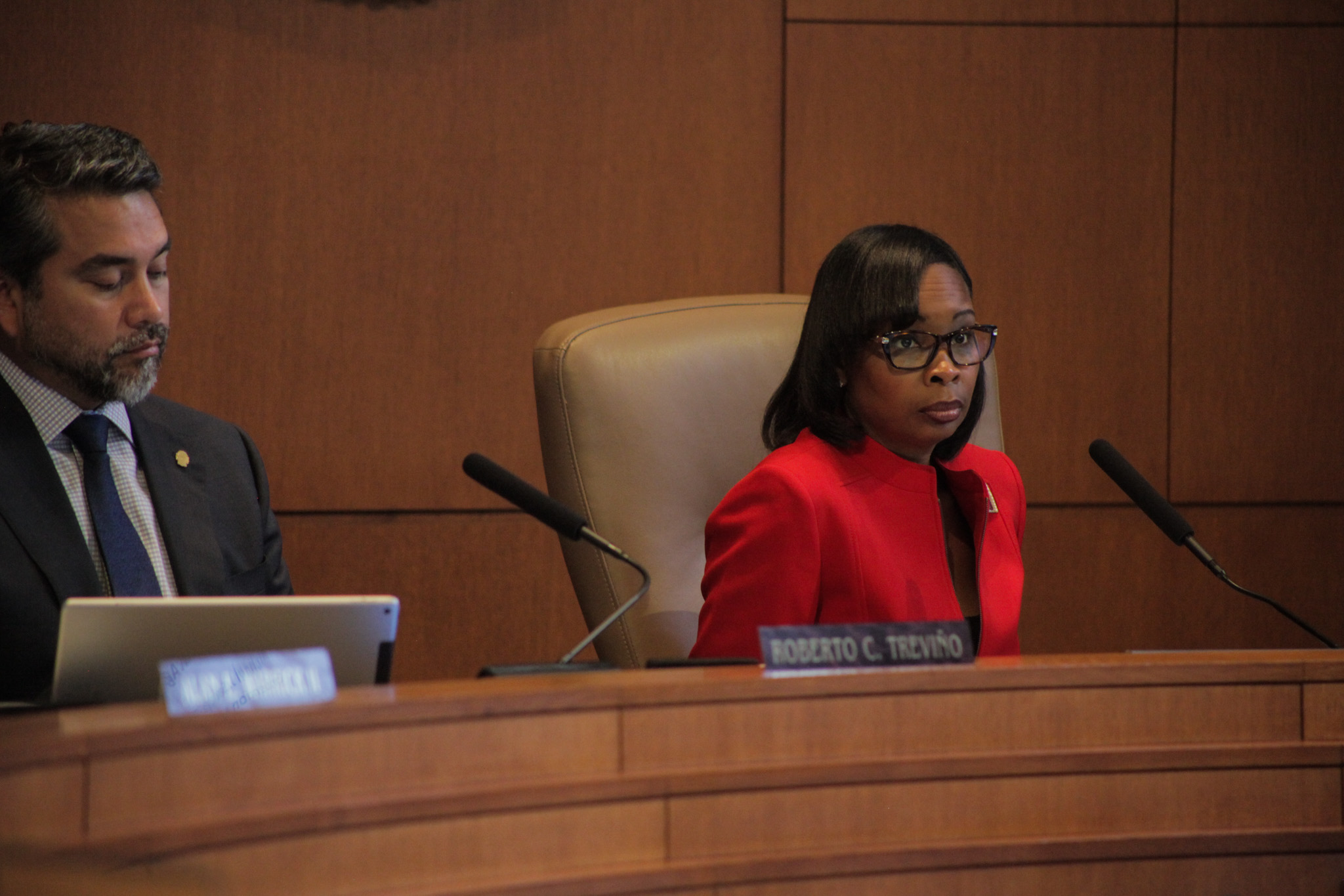 Mayor Ivy Taylor listens to community members testify at her final city council meeting.