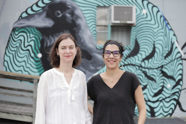 Executive director at Luminaria Kathy Armstrong and Director of South Town the Arts District Yvette Benavides stand in front of the Grackle mural at one of their locations for their day festival.