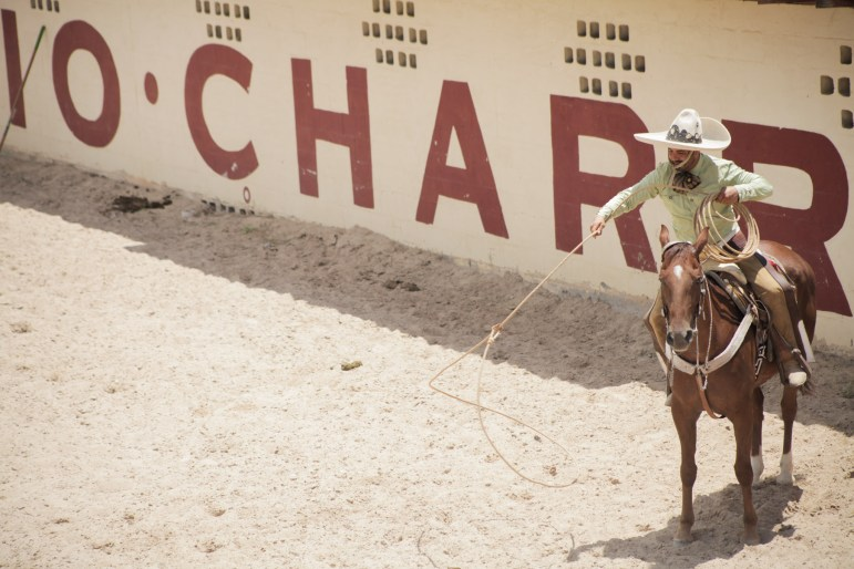 A charro practices roping before he competes at the 70th anniversary of the Charreada in San Antonio.