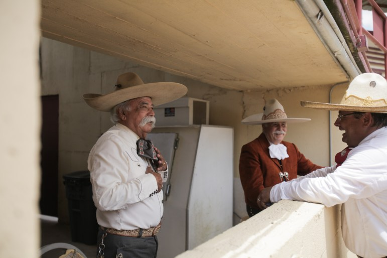 Announcers chat along the sidelines of the 70th anniversary of Charreada in San Antonio.