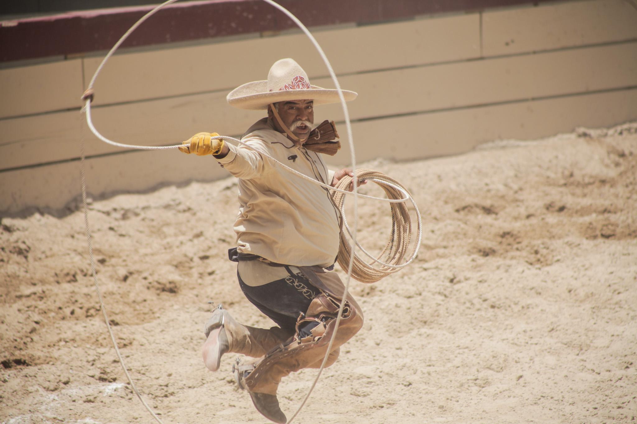 A competing charro participates in piiales at the 70th anniversary Charreada.