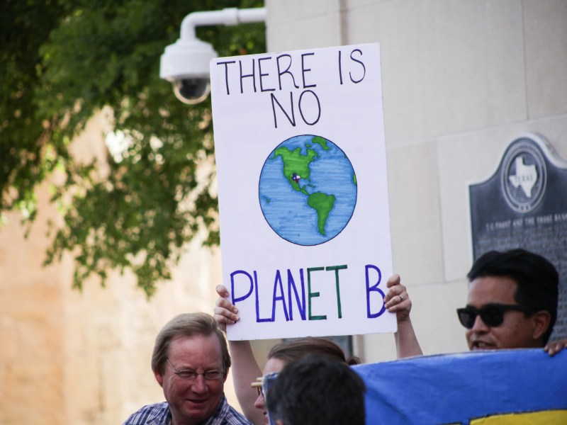 "Supporters hold up signs stating ""There is no plan(et) B"" at the rally for the Paris climate accord."
