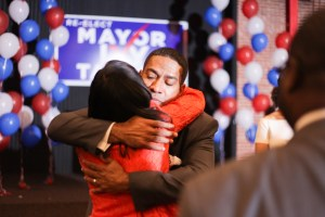 """Councilman-elect William """"Cruz"""" Shaw (D2) hugs Ivy Taylor after her concession speech."""
