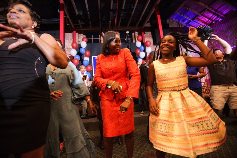 Mayor Ivy Taylor and her daughter Morgan (right), laugh on the dance floor after Taylor conceded defeat.