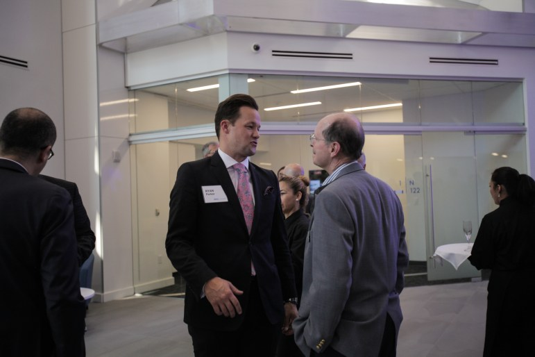 Ryan Parker socializes at the BBVA grand opening at the Weston Center.