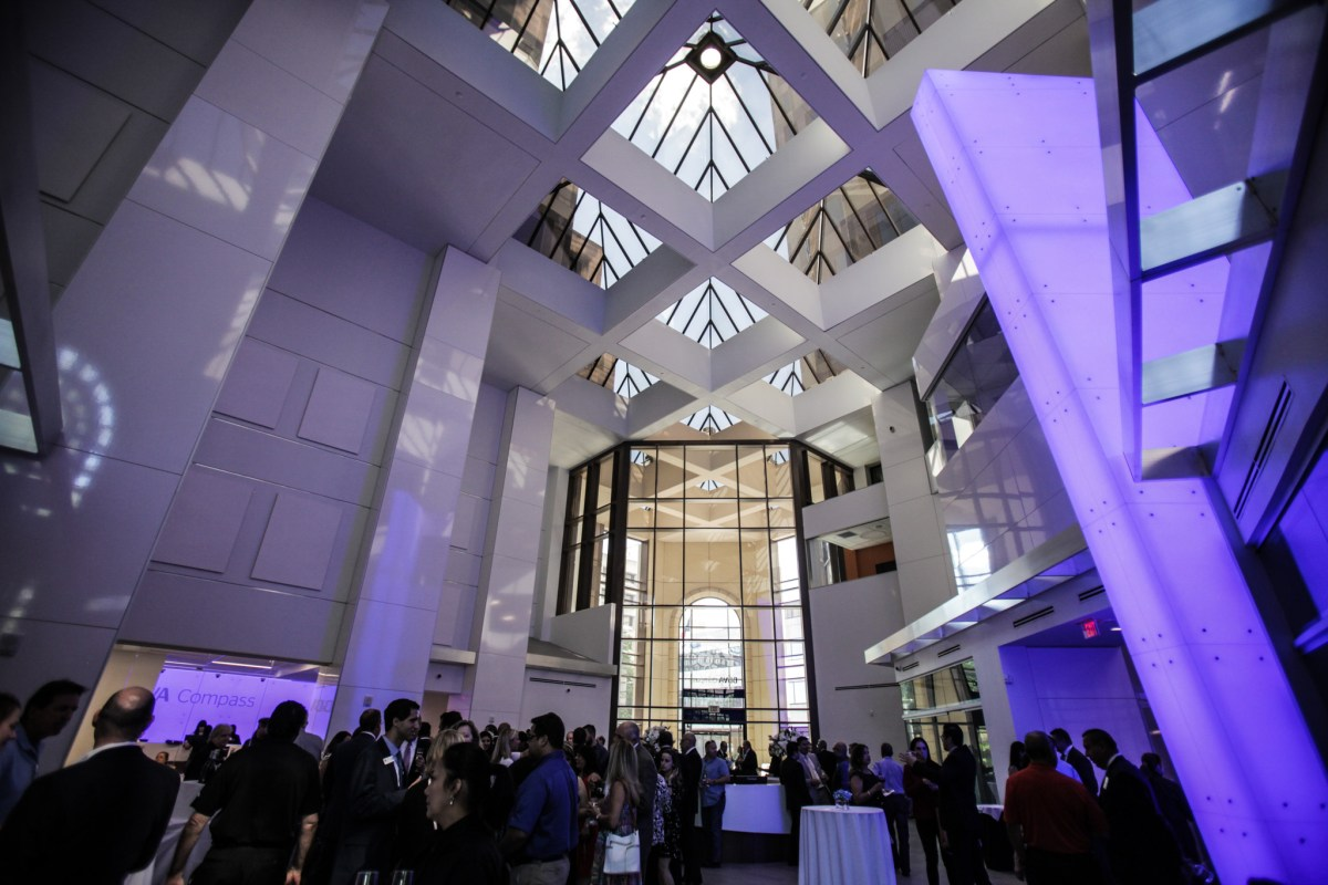 A blue compass art installation illuminates the new BBVA branch at the grand opening at the Weston Centre.