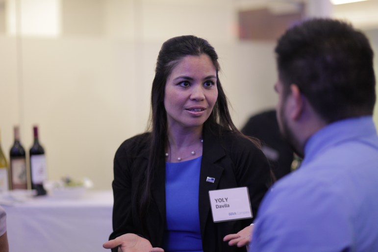BBVA Compass community relations executive Yoly Davila chats with fellow businessmen at the BBVA Compass grand opening at the Weston Centre.