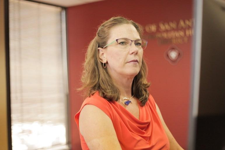 San Antonio's new Metro Health director Colleen Bridger works at her standing desk at the Metropolitan Health District building.