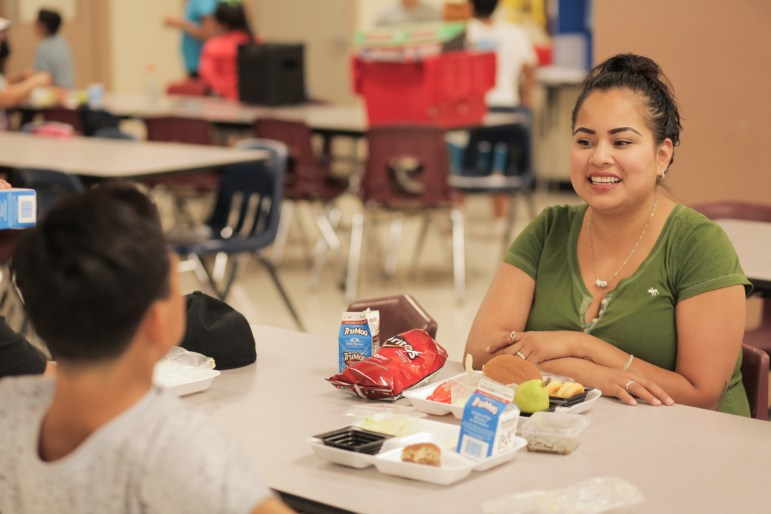 Community members benefit from the summer food program at Rhodes Middle School.