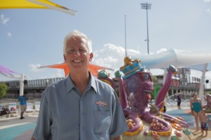 Gordon Hartman stands in front of the new waterpark at Morgan's Inspiration Island.