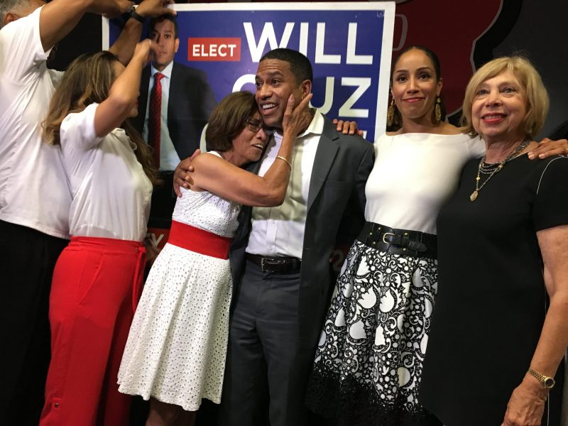 William Cruz Shaw embraces with his mother Sandra Cruz ollowing his victory of City Council of District 2.
