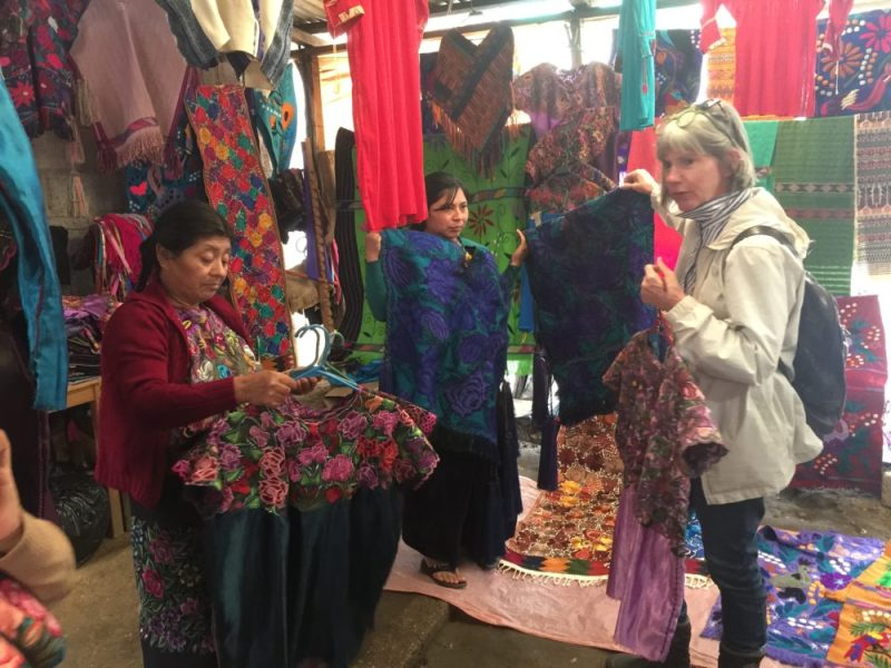 Kathy picking out a few new huipiles in San Cristobal de Las Casas for her collection.