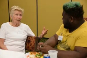 Meadows resident Marti Redman chats with Project Transformation intern Victor Edwards.