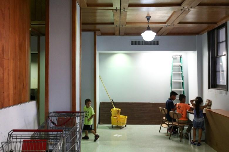 Children play together in a corner of the Ella Austin Community Center.
