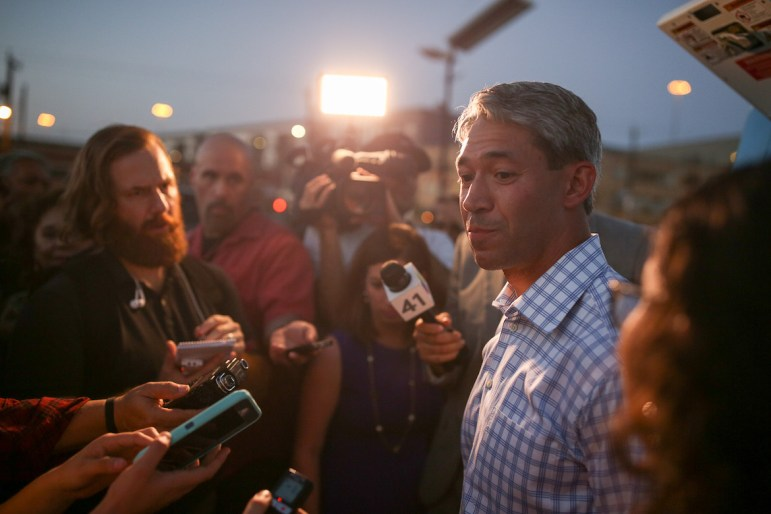 Ron Nirenberg speaks with reporters as runoff election results trickle in.