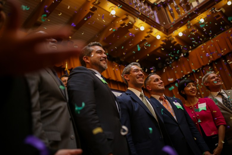 City Council and Mayor Ron Nirenberg pose for a portrait as confetti falls during the New City Council Reception hosted by the The San Antonio Chamber of Commerce and the North San Antonio Chamber of Commerce.