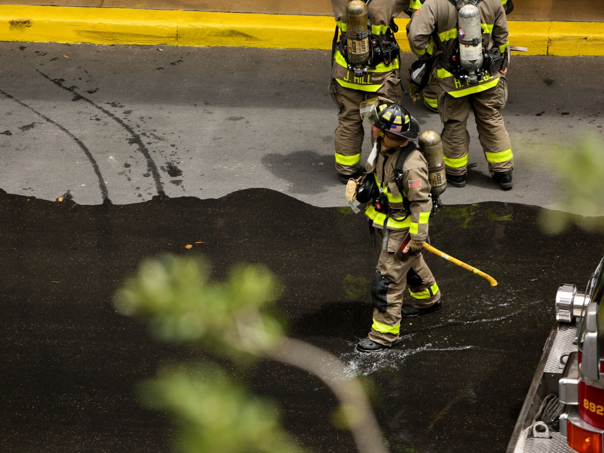 San Antonio Firefighters walk through leaking hydrant water during the emergency.