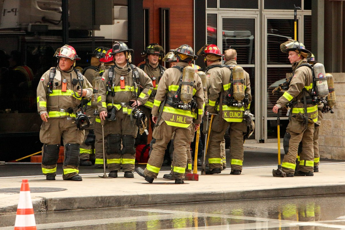 San Antonio firefighters await their turn to enter the scene of the fire.