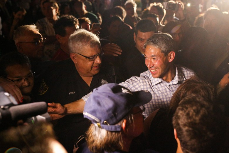 Mayor-elect Ron Nirenberg stretches his arm to shake a supporter's hand after Mayor Ivy Taylor concedes defeat.