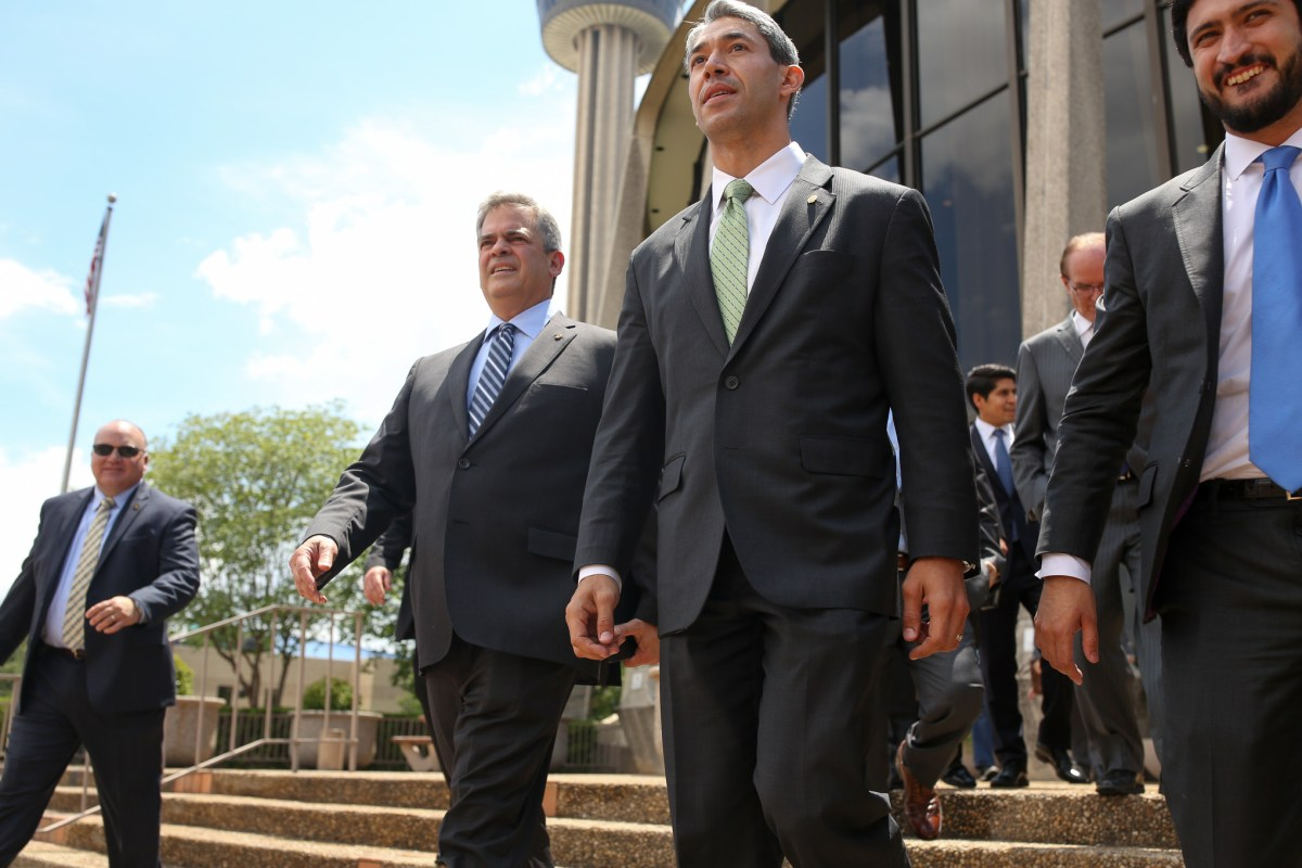 (from left) Austin Mayor Steve Adler, San Antonio Mayor Ron Nirenberg, and Austin Councilman Greg Casar (D4) approach the protest outside the John H Wood United States Courthouse.