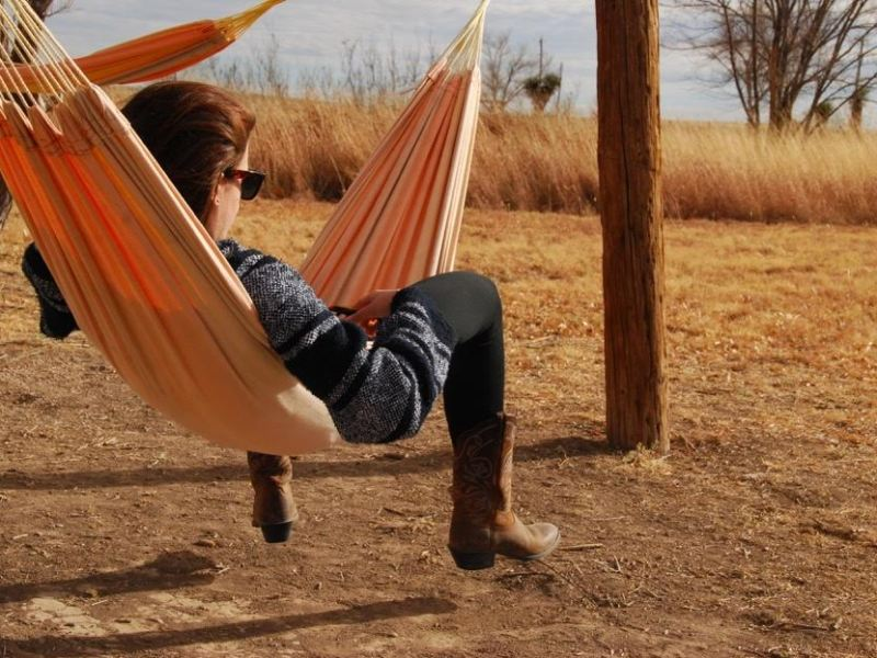 The author relaxes in a hammock in Marfa, Texas.