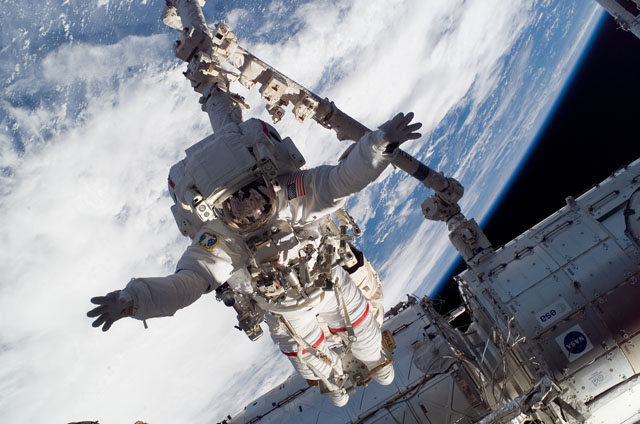 Astronaut Rick Linnehan participates in Expedition 16/STS-123 EVA 1's first scheduled session of extravehicular activity as construction and maintenance continue on the International Space Station.