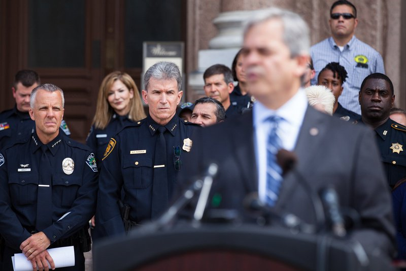 Austin Police Chief Brian Manley and San Antonio Police Chief William McManus stand behind Austin Mayor Steve Adler on the steps of the state Capitol on July 25, 2017.