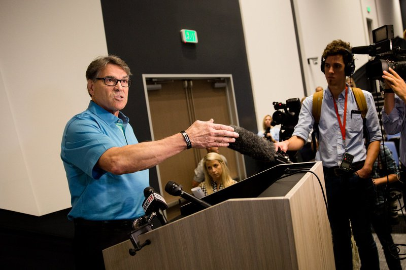 U.S. Secretary of Energy Rick Perry speaks to the press after touring the Daikin Texas Technology Park in Waller, Texas, on July 28, 2017.