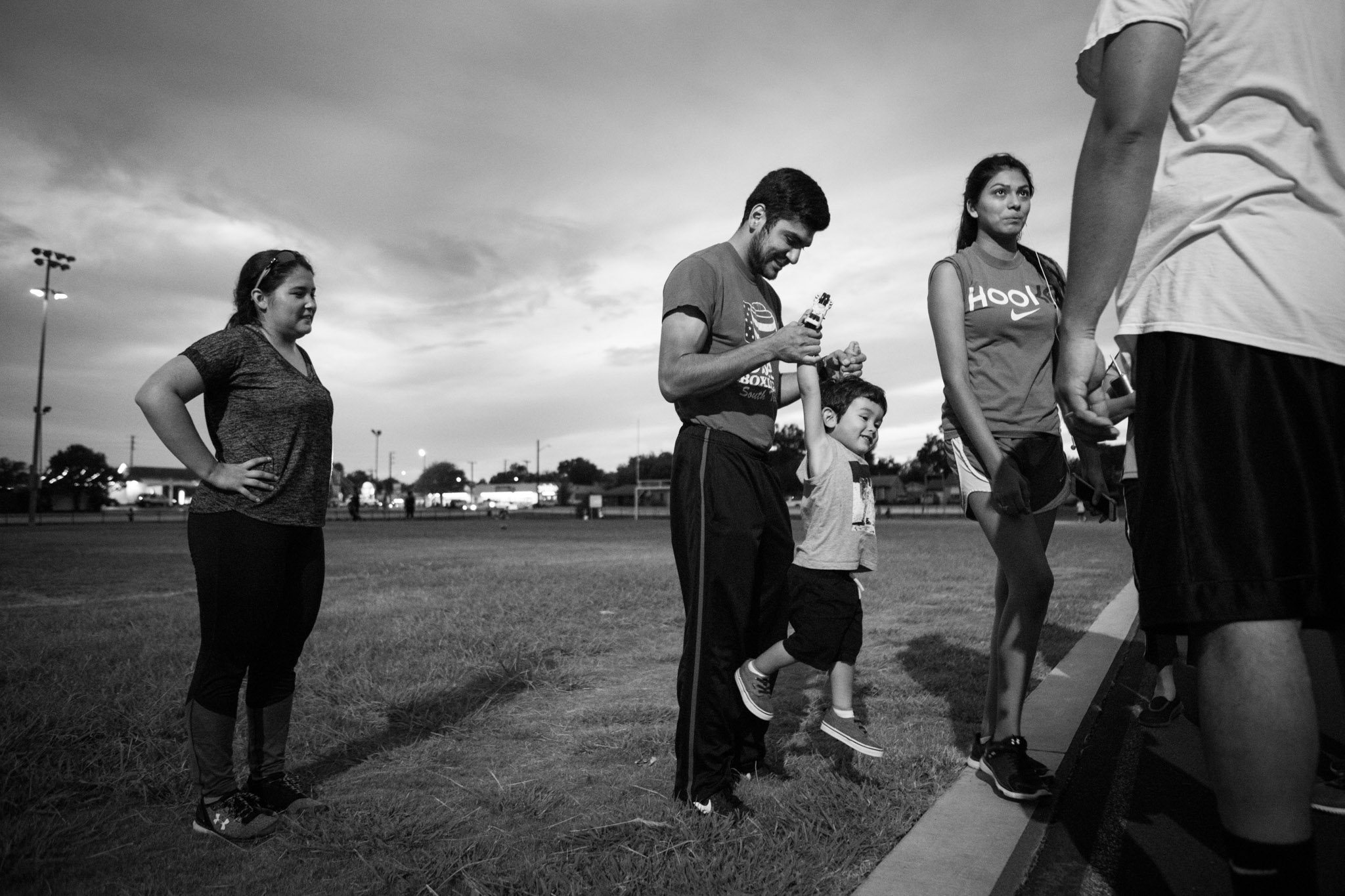(From left) Alaska Martinez, Jimmy Martinez, Jimmy, 2, and Mary Martinez prepare to leave after spending an hour running around the track at Thomas Edison High School.
