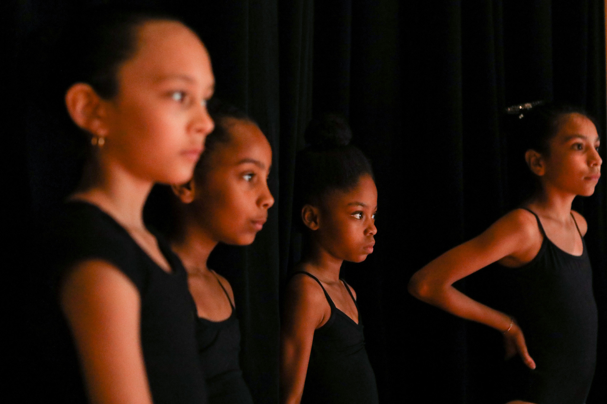 Dancers line up to practice for their final performance at the Carver's Summer Dance Intensive Program taught by Dallas Black Dance Theatre professional dancers.