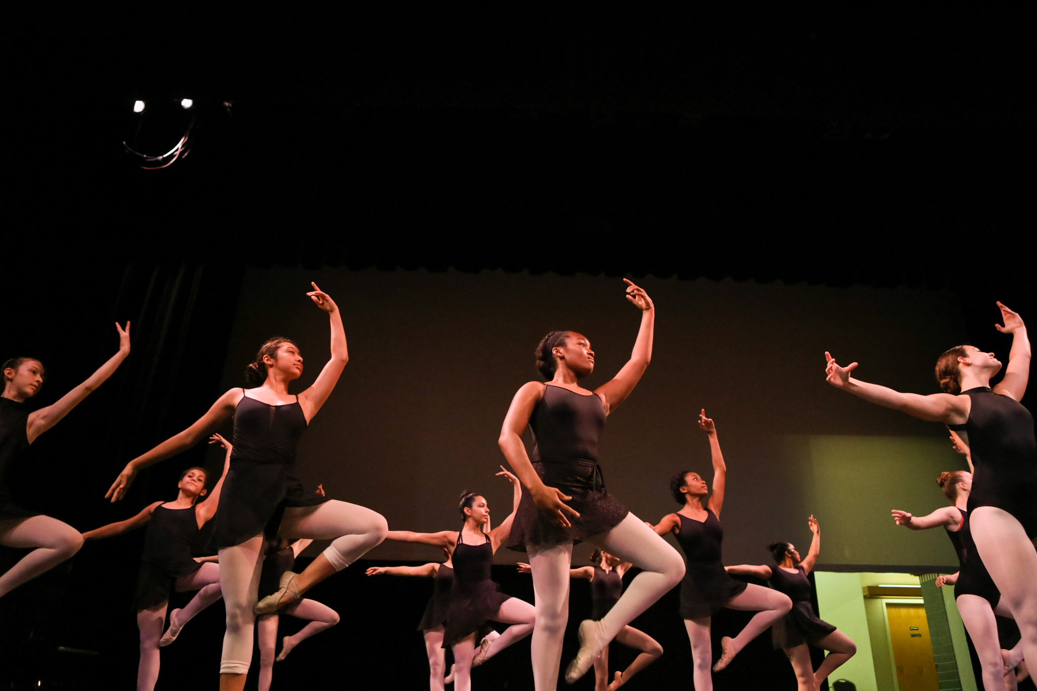 Dancers practice for their final performance at the Carver's Summer Dance Intensive Program taught by Dallas Black Dance Theatre professional dancers.