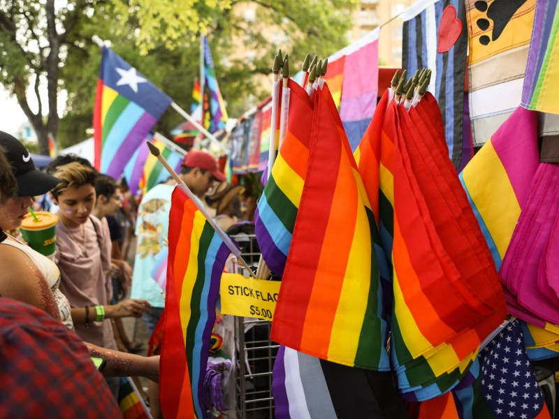Attendees shop for flags at the PRIDE Bigger Than Texas Festival.