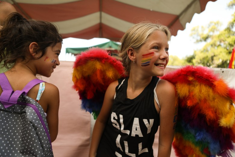(From left) Joplin, 6, and Harper, 10, sport rainbow face paint at the PRIDE Bigger Than Texas Festival.