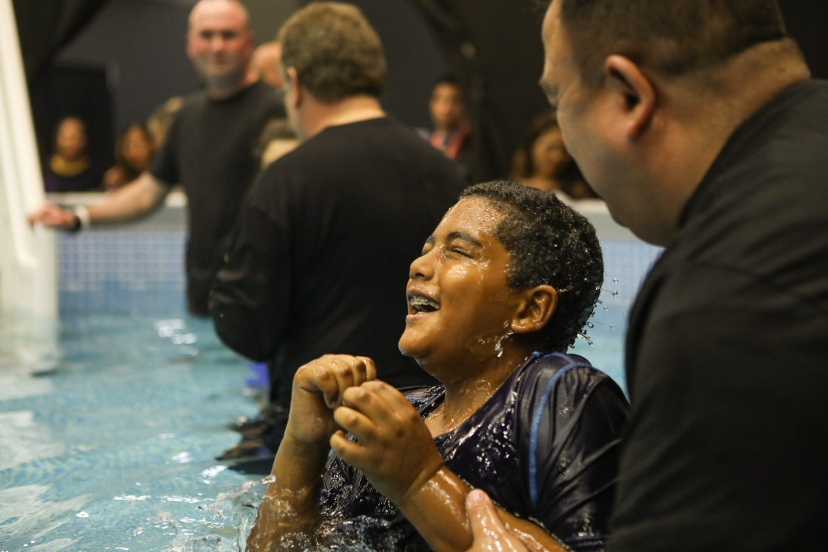 Malachi, 10, smiles after being baptized during the 2017 convention of Jehovah's Witnesses in the Freeman Coliseum.