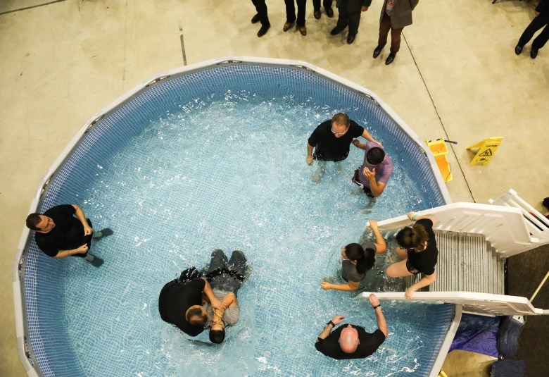 A boy is baptized during the 2017 convention of Jehovah's Witnesses in the Freeman Coliseum.