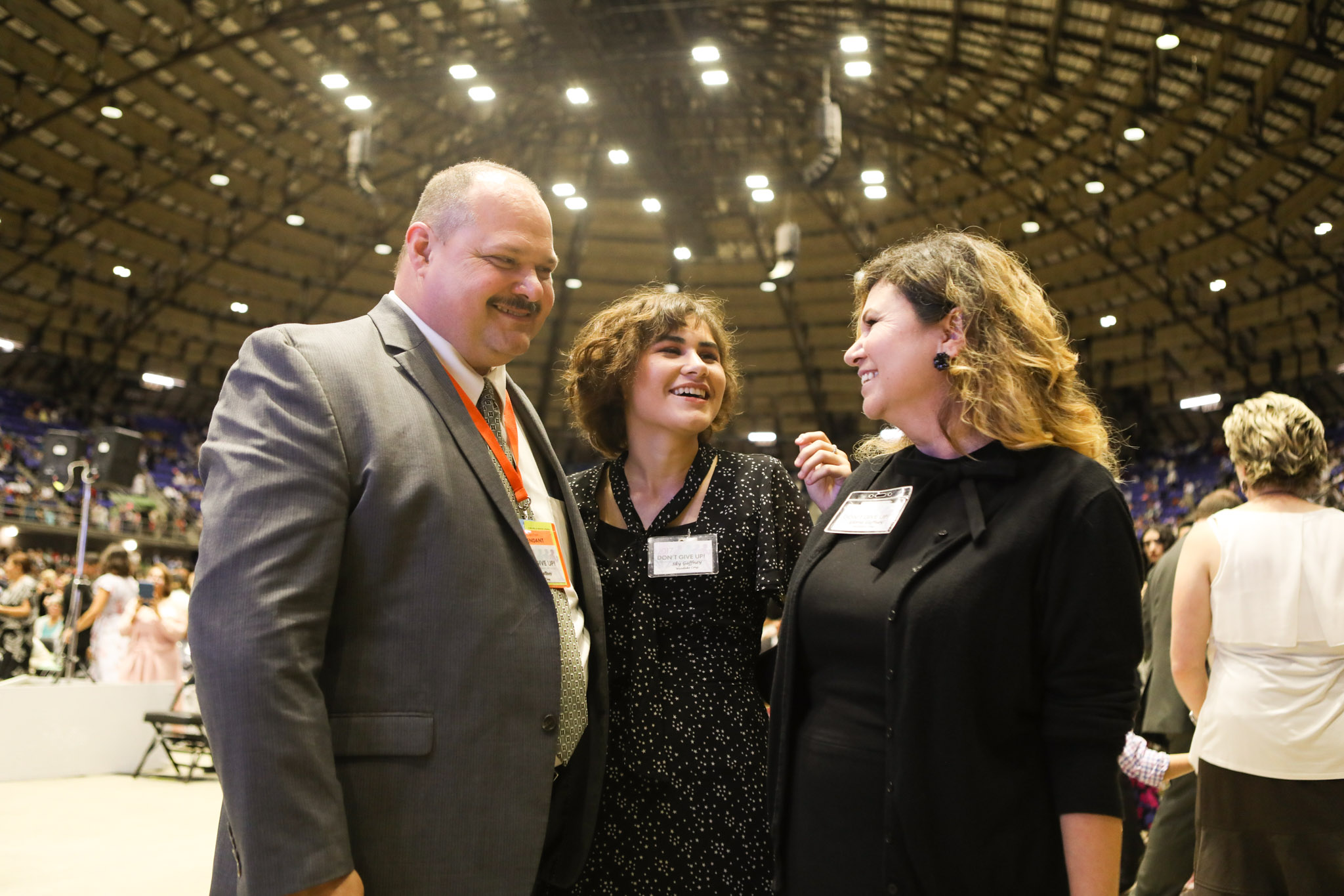 (From left) Mike Gaffney, Sky, 15, and Gloria Gaffney share a laugh during the 2017 convention of Jehovah's Witnesses in the Freeman Coliseum.