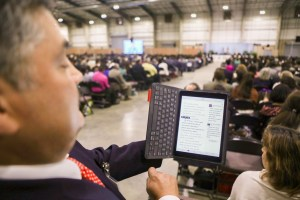 Blas Cantu uses his JW Library app to follow along with passages in the Bible during the 2017 convention of Jehovah's Witnesses in the Freeman Coliseum.