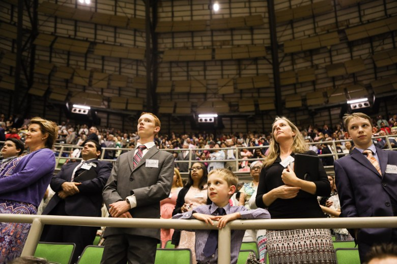 The audience stands in honor of the baptism during the 2017 convention of Jehovah's Witnesses in the Freeman Coliseum.