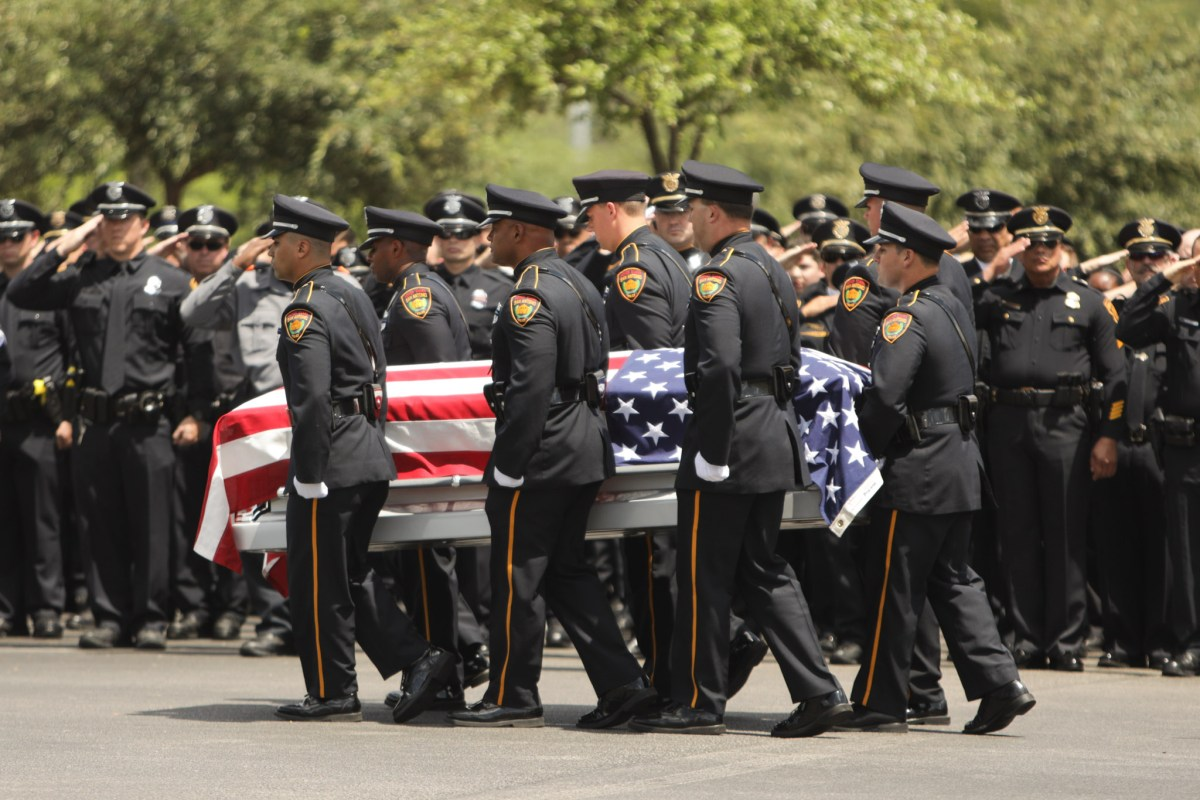 The casket of fallen SAPD officer Miguel Moreno is carried outside of Community Bible Church.