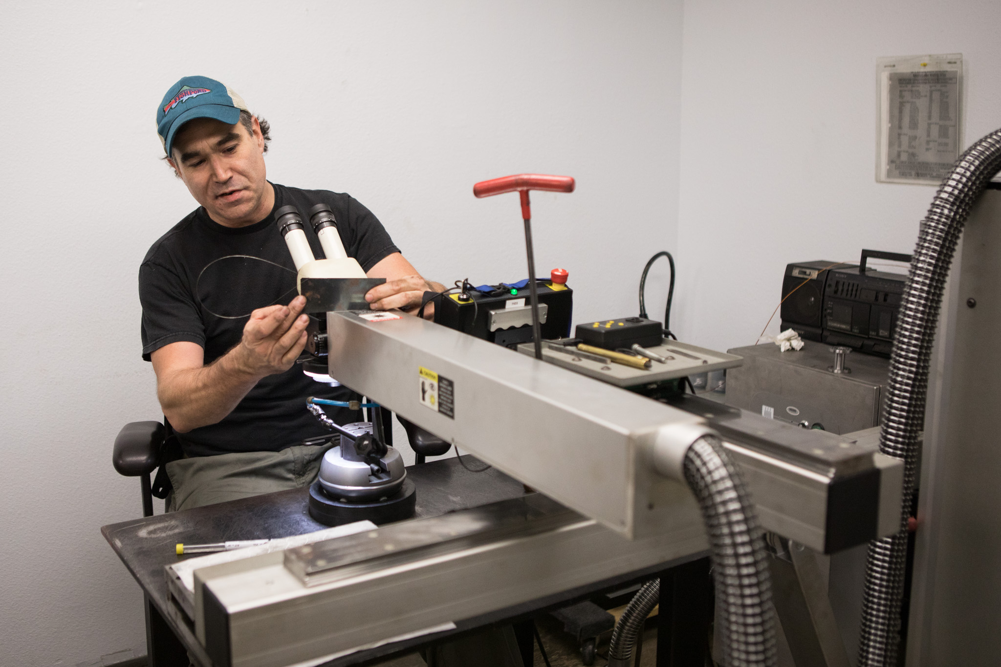 Precision Mold & Tool Group Lead Mold Maker Mike Pasley operates a 300-watt Y.A.G. laser.