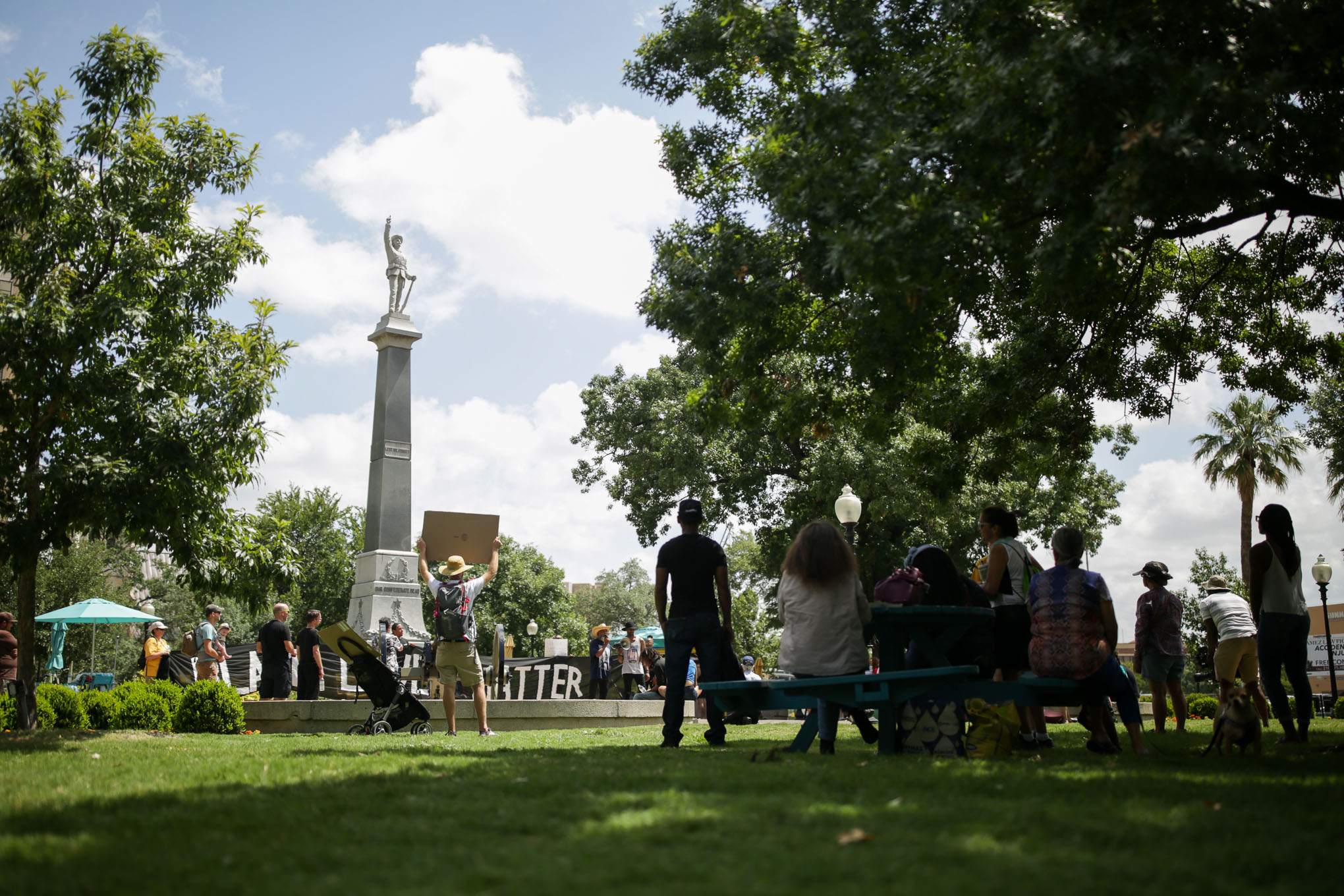 The Confederate monument raises 40 feet above the ground and is centered directly in the middle of Travis Park in downtown San Antonio.